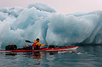 Paddeling by an ice berg