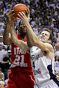 Utah forward Will Clyburn, left, and BYU guard Jackson Emery, right, battle for a rebound during the second half of an NCAA college basketball game in Provo, Utah, Saturday, Feb. 12, 2011. BYU defeated Utah 72-59. (AP Photo/Colin E Braley)