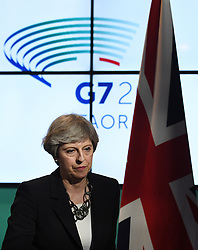 Prime Minister Theresa May during a press conference at the G7 summit at Teatro Greco in Taormina, Sicily, Italy.