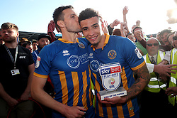 Shrewsbury Town's winner of the Man of the Match award Ben Godfrey (right) and Mat Sadler at the end of the Sky Bet League One play-off second leg match at Montgomery Waters Meadow, Shrewsbury.