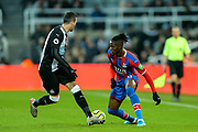 Wilfried Zaha (#11) of Crystal Palace takes on Javi Manquillo (#19) of Newcastle United during the Premier League match between Newcastle United and Crystal Palace at St. James's Park, Newcastle, England on 21 December 2019.