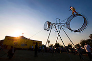Acrobats Guillermo Perez, right, and Migel Angel Perez perform outdoors as the sun sets over the tent of the American Crown Circus/Circo Osorio on Saturday, June 14, 2008. The circus was in a vacant lot on Second Street in downtown Antioch, California.  (Photo by Kevin Bartram)