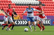 Rochdale midfielder Daniel Adshead (25) holding off Charlton Athletic defender Ben Purrington (16) during the EFL Sky Bet League 1 match between Charlton Athletic and Rochdale at The Valley, London, England on 4 May 2019.