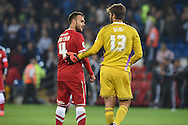 Dimi Konstantopoulos , the Middlesbrough goalkeeper ® chats to Juan Cala of Cardiff city at the end of the match. Skybet football league championship match, Cardiff city v Middlesbrough at the Cardiff city stadium in Cardiff, South Wales on Tuesday 16th Sept 2014<br /> pic by Andrew Orchard, Andrew Orchard sports photography.