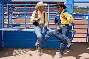 10 SEPTEMBER 2004 - WINDOW ROCK, AZ: Cowboys behind the chutes at the seniors rodeo  during the 58th annual Navajo Nation Fair in Window Rock, AZ. Slivers said he has been rodeoing since 1963 and was the 2002 bullriding champion for cowboys more than 50 years old on the Navajo reservation. The Navajo Nation Fair is the largest annual event in Window Rock, the capitol of the Navajo Nation, the largest Indian reservation in the US. The Navajo Nation Fair is one of the largest Native American events in the United States and features traditional Navajo events, like fry bread making contests, pow-wows and an all Indian rodeo.  PHOTO BY JACK KURTZ