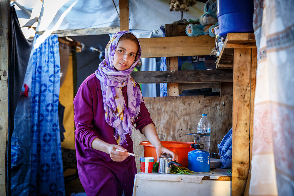 2016 July-Ritsona Refugee Camp, Ritsona, Greece. A 28-year-old mother of four in her makeshift home.