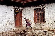 BHUTAN, LAYA VILLAGE, school boy w/ books