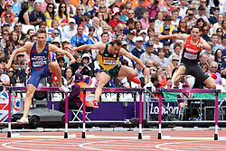 JJ van Zyl of South Africa (Centre) competes with Josef Prorok of CZE (L) and  Silvio Schirrmeister of Germany (R) in round 1 of the Men's 1\400m Hurdles during day 1 of athletics held at the Olympic Stadium in Olympic Park in London as part of the London 2012 Olympics on the 3rd August 2012..Photo by Ron Gaunt/SPORTZPICS