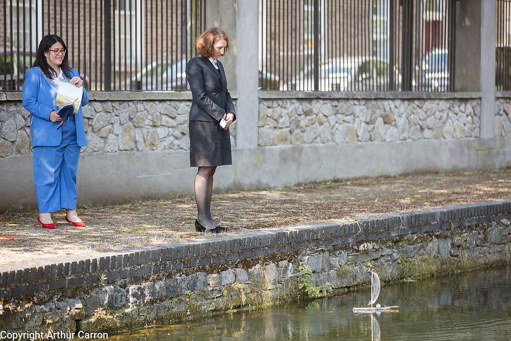 NO FEE PICTURES<br /> Dublin, 28 May 2021       Marking the 80th Anniversary of the bombing of North Strand and remembering the 28 people who lost their lives in 1941 at a wreath laying ceremony, organised by the North Strand Bombing Commemoration Committee, at Marino College, North Strand Street were:  Lord Mayor of Dublin Hazel Chu, Her Excellency Deike Potzel, German Ambassador to Ireland, putting a miniture sail boat into the canal to commeemorate the victims. Photographs: Arthur Carron