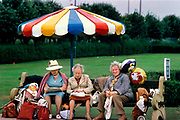 Campers waiting for their coach home, Butlins holiday camp, Skegness. Butlins Skegness is a holiday camp located in Ingoldmells near Skegness in Lincolnshire. Sir William Butlin conceived of its creation based on his experiences at a Canadian summer camp in his youth and by observation of the actions of other holiday accommodation providers, both in seaside resort lodging houses and in earlier smaller holiday campsThe camp began opened in 1936, when it quickly proved to be a success with a need for expansion. The camp included dining and recreation facilities, such as dance halls and sports fields. Over the past 75 years the camp has seen continuous use and development, in the mid-1980s and again in the late 1990s being subject to substantial investment and redevelopment. In the late 1990s the site was re-branded as a holiday resort, and remains open today as one of three remaining Butlins resorts.