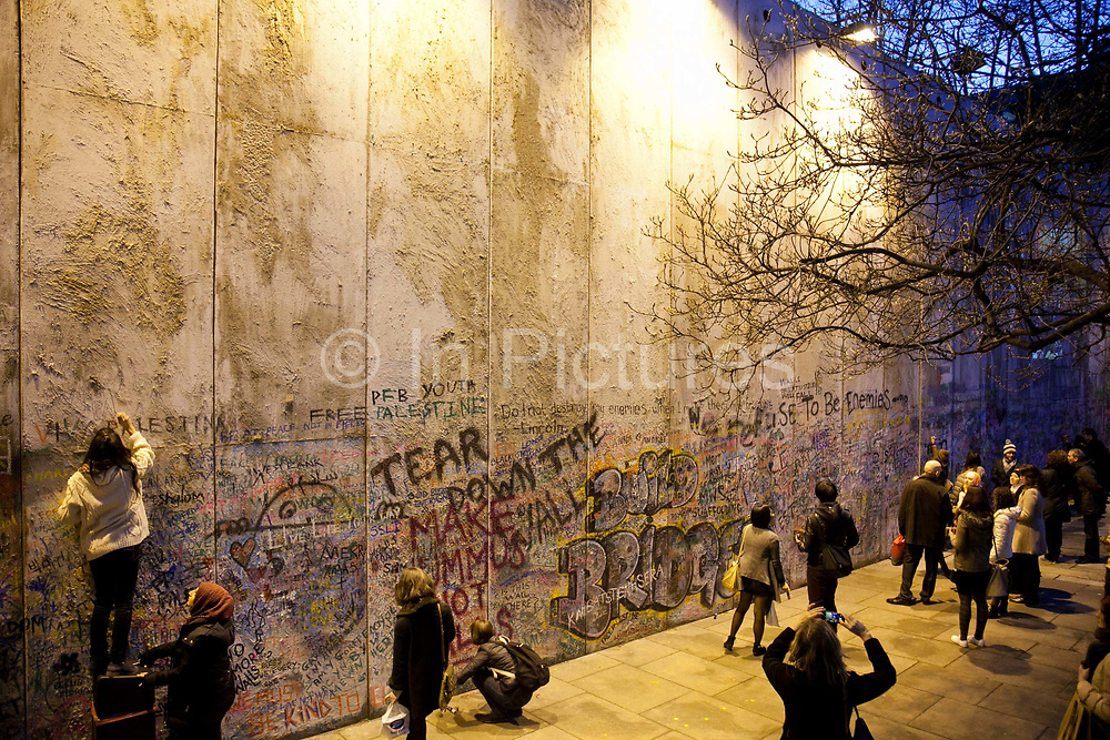 As part of the Bethlehem Unwrapped Christmas celebration of Bethlehem held at St James' Church in Piccadilly an 8 meter high replica of the Israeli separation wall is on display. The wall is high enough to almost hide the entire church and the wall has become a canvas for people to write their comments about the wall and the Israeli occupation of the West Bank and Gaza. The wall was inaugurated Dec 23 and will come down after the closing party Jan 5th.