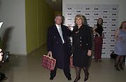 Sir Nicholas Lloyd and Lady Lloyd leaving the Talk pre-Bafta party with their Burberry gift bags. St. Martin's Lane Hotel. London. 24 February 2001. © Copyright Photograph by Dafydd Jones 66 Stockwell Park Rd. London SW9 0DA Tel 020 7733 0108 www.dafjones.com