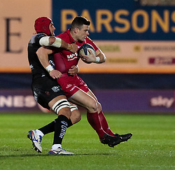 Scarlets' Scott Williams is tackled by Toulon's Juandre Kruger<br /> <br /> Photographer Simon King/Replay Images<br /> <br /> European Rugby Champions Cup Round 6 - Scarlets v Toulon - Saturday 20th January 2018 - Parc Y Scarlets - Llanelli<br /> <br /> World Copyright © Replay Images . All rights reserved. info@replayimages.co.uk - http://replayimages.co.uk