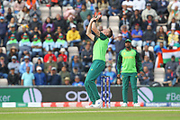 Cricket - 2019 ICC Cricket World Cup - Group Stage: South Africa vs. India<br /> <br /> Chris Morris of South Africa takes a tumble over the wickets whilst catching MS Dhoni of India during the cricket world cup match at the Hampshire Bowl Southampton England<br /> <br /> COLORSPORT/SHAUN BOGGUST