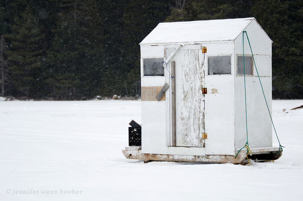 A white-painted ice fishing hut on Eagle Lake, Acadia National Park, Maine.