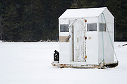 A white-painted ice fishing hut on Eagle Lake, Acadia National Park, Maine.