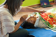 During a Reiki session the Healing House, in the district of San Blas