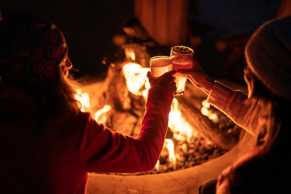 A winter evening around the campfire at Staffords Crooked River Lodge near Petoskey, Michigan.