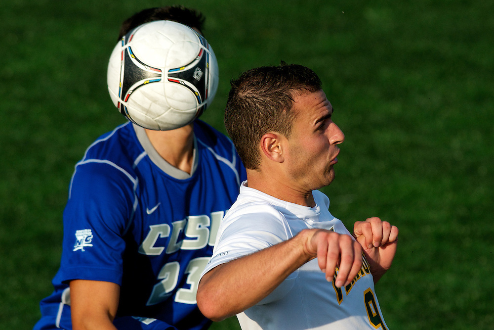 Catamounts forward Zach Paul (9) heads the ball during the men's soccer game between the Central Connecticut State University Blue Devils and the Vermont Catamounts at Virtue Field on Friday afternoon September 7, 2012 in Burlington, Vermont.