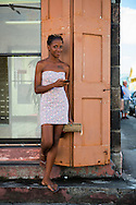 A young woman stands outside the post office in Basseterre, Saint Kitts and Nevis