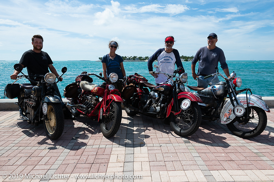 Andrea Labarbara, Loring Hill (L) and Mark Hill (R) of the Wolf Pack (4-cylinders) with Bob Zeolla and his Knucklehead on the Cross Country Chase motorcycle endurance run from Sault Sainte Marie, MI to Key West, FL. (for vintage bikes from 1930-1948). The Grand Finish in Key West's Mallory Square after the 110 mile Stage-10 ride from Miami to Key West, FL and after covering 2,368 miles of the Cross Country Chase. Sunday, September 15, 2019. Photography ©2019 Michael Lichter.