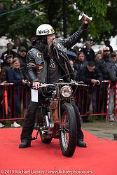 Christian Ekwall of Sweden collects an award for his custom Norton on stage during the Twin Club's annual Motorcycle Show in Norrtälje, Sweden. Saturday, June 1, 2019. Photography ©2019 Michael Lichter.
