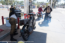 Shinya Kimura takes a break to stretch while stopping to fuel his 1915 Indian on the eastern plains of Colorado during the Motorcycle Cannonball Race of the Century. Stage-9 Dodge City, KS to Pueblo, CO. USA. Monday September 19, 2016. Photography ©2016 Michael Lichter