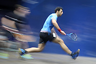 Omar Mosaad of Egypt plays a shot against Mathieu Castagnet of France in the final , Canary Wharf Squash Classic 2016 , at the East Wintergarden in Canary Wharf , London on Friday 11th March 2016.<br /> pic by John Patrick Fletcher, Andrew Orchard sports photography.