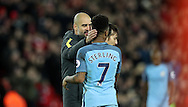 Manchester City Manager Pep Guardiola and Raheem Sterling of Manchester City after the English Premier League match at Anfield Stadium, Liverpool. Picture date: December 31st, 2016. Photo credit should read: Lynne Cameron/Sportimage