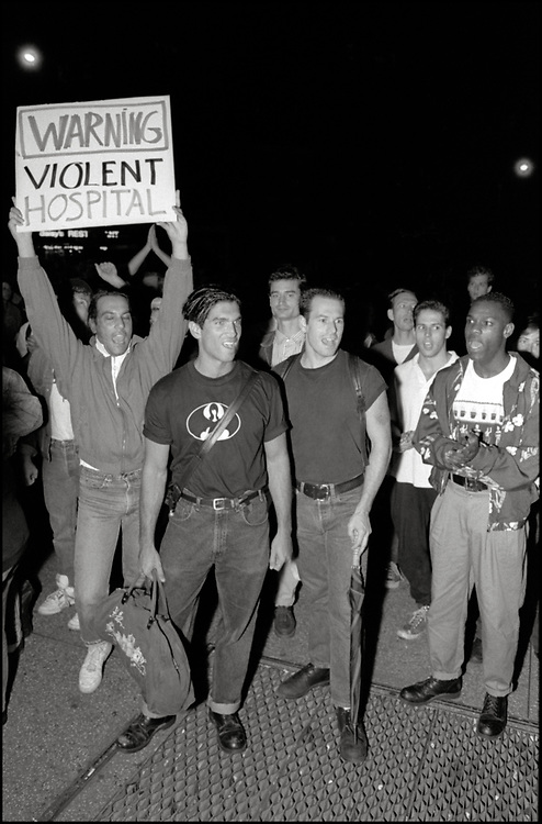 At a Monday night ACT UP meeting in September 1989, it was brought to the floor that a gay man had been kicked out of the ER at St. Vincents Hospital by a security guard because he had dared to kiss his lover. A heated conversation ensued and eventually the whole room got up, walked around the corner to the hospital and took over the waiting room in the ER. As a result, the hospital agreed to meet with representatives of ACT UP.<br /> <br /> Several ACT UP members met with the president of the hospital and the executive board, which resulted in sensitivity training for all of their employees.