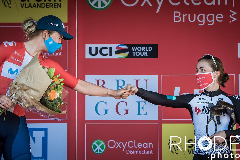 podium with race winner Grace Brown (AUS/BikeExchange) congratulated by Emma Norsgaard (DEN/Movistar)<br /> <br /> Oxyclean Classic Brugge-De Panne 2021 (WE/1.WWT) - Belgium<br /> 1 day race from Brugge to De Panne (159km)<br /> <br /> ©RhodePhoto