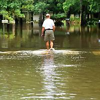 A man walks through the flood streets when Tropical Strom Allison hit the area.     (Photo by Kim Christensen)