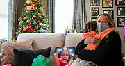 """Jenny Meicher Santek, board chair of the Boys & Girls Club, hugs Anija Scott during the reveal of Irene """"GG"""" Alexander's home makeover Dec. 18th. In 2020, GG lost five members of her family, including her husband of 41 years to cancer and her 11-year-old great-granddaughter to gun violence. (Photo © Andy Manis)"""