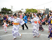 """Costumed dancers move counter-clockwise around the central stage during the """"bon odori"""" dances at the end of Sunday's 63rd annual Obon Festival at the Buddhist Temple of Salinas."""