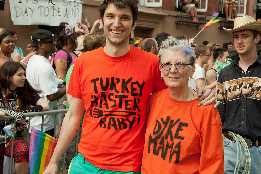 """Mother and son in the 2011 Pride Parade in New York's West Vllage. He is wearing a tee shirt lettered """"Turkey baster baby"""" and she is wearing one letterd """"Dyke Mama."""" The are part of COLAGE, which represents children with a lesbian, gay, bisexual or transgendered parent."""