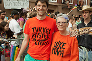 "Mother and son in the 2011 Pride Parade in New York's West Vllage. He is wearing a tee shirt lettered ""Turkey baster baby"" and she is wearing one letterd ""Dyke Mama."" The are part of COLAGE, which represents children with a lesbian, gay, bisexual or transgendered parent."