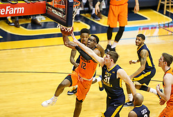Feb 10, 2018; Morgantown, WV, USA; Oklahoma State Cowboys forward Cameron McGriff (12) drives baseline during the first half against the West Virginia Mountaineers at WVU Coliseum. Mandatory Credit: Ben Queen-USA TODAY Sports