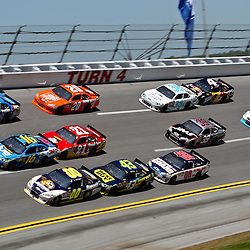April 17, 2011; Talladega, AL, USA; NASCAR Sprint Cup Series driver Kyle Busch (18), Greg Biffle (16) and David Reutimann (00) lead a pack going three wide on turn four during the Aarons 499 at Talladega Superspeedway.   Mandatory Credit: Derick E. Hingle