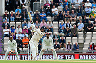 Sam Curran of England goes on the attack and hits the ball for 4 runs during the first day of the 4th SpecSavers International Test Match 2018 match between England and India at the Ageas Bowl, Southampton, United Kingdom on 30 August 2018.