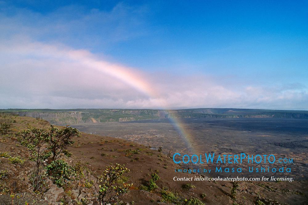 Rainbow over Halema`uma`u or Halemaumau Crater and Mauna Loa, Kilauea Caldera, Hawaii, USA Volcanoes National Park, Big Island, Hawaii, USA