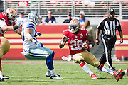 San Francisco 49ers running back Carlos Hyde (28) slips during a carry against the Dallas Cowboys at Levis Stadium in Santa Clara, Calif., on October 2, 2016. (Stan Olszewski/Special to S.F. Examiner)