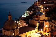Twilight falls over Positano and the Li Galli Islands on the Amalfi Coast, Campagna, Italy, as seen from Le Sirenuse Hotel.