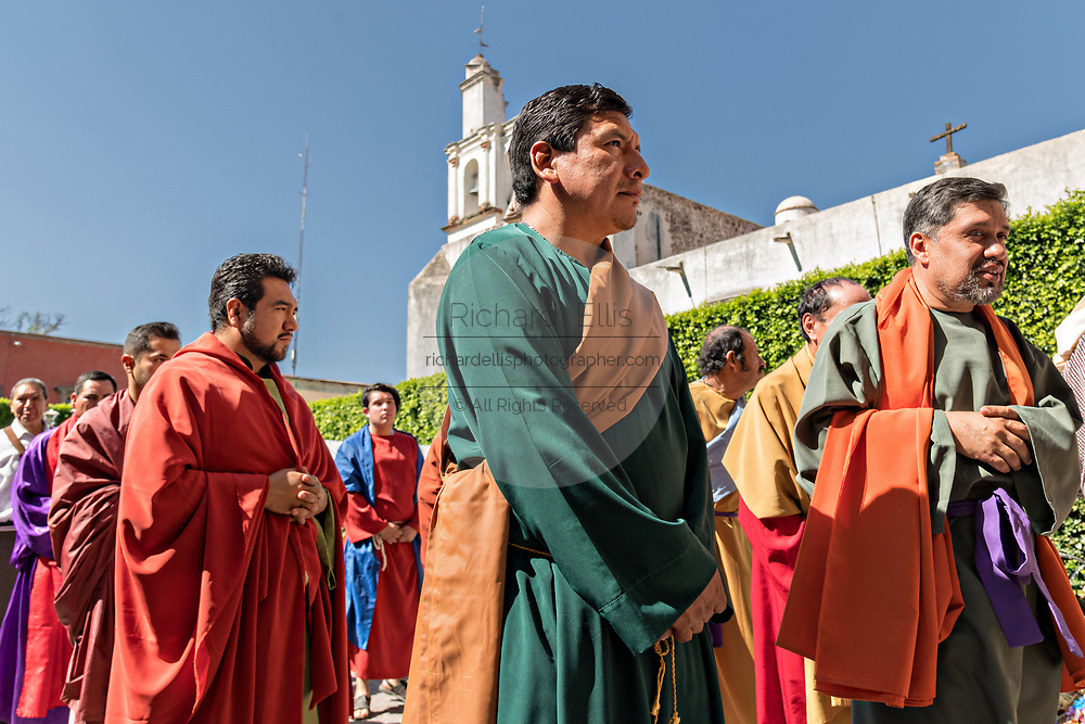 The 12 disciples of Jesus during a Palm Sunday procession through the streets at the start of Holy Week March 25, 2018 in San Miguel de Allende, Mexico. Christians commemorate the entry of Jesus into Jerusalem when it was believed that the citizens laid down palm branches in his path.