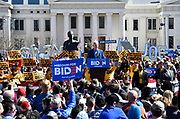 """Former Vice-President Joe Biden speaks at a Get Out The Vote rally at Kiener Plaza in downtown St.Louis, Missouri, USA. Behind him at left is a statue entitled """"The Runner"""" named for former Olympian and St. Louis native Harry Kiener, for whom the plaza is named.  The builidng in background is the Old Courthouse.<br />Tim VIZER/AFP"""