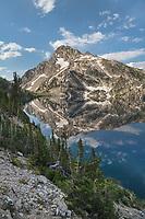 Mount Regan mirrored in still waters of Sawtooth Lake at sunrise. Sawtooth Mountains Wilderness Idaho