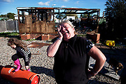 Mary McCarthy laughing in defiance at the situation at Dale Farm site prior to eviction. Riot police and bailiffs were present on 20th October 2011, as the site was cleared of the last protesters chained to barricades. Dale Farm is part of a Romany Gypsy and Irish Traveller site in Crays Hill, Essex, UK. <br /> <br /> Senior resident Kathleen McCarthy said she now wished to leave, once obstacles are removed, and the majority of residents are expected to join her. Most plan to relocate to Oak Road, on the neighbouring legal site.<br /> <br /> Dale Farm housed over 1,000 people, the largest Traveller concentration in the UK. The whole of the site is owned by residents and is located within the Green Belt. It is in two parts: in one, residents constructed buildings with planning permission to do so; in the other, residents were refused planning permission due to the green belt policy, and built on the site anyway.
