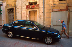 MALTA GOZO VICTORIA JUL00 - A Maltese man passes a luxury car parked in Old Victoria.. . jre/Photo by Jiri Rezac. . © Jiri Rezac 2000. . Tel:   +44 (0) 7050 110 417. Email: info@jirirezac.com. Web:   www.jirirezac.com