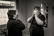 One vital aspect of keeping staff safe when dealing with Covid / suspected Covid patients, is to ensure the accurate and vital fitting of face masks for staff. <br /> <br /> Away from the main wards, in a portable unit here at Ysbyty Glan Clwyd, a senior nurse is being taken through vital instruction about accurate mask fitting, so that she remains safe whilst treating patients & working with other staff.  <br /> <br /> From my exhibition series for Betsi Cadwaladr via the Betsi Research Unit.<br /> <br /> My brief was not frontline action as seen on all news outlets, but the way hospitals & staff have adapted to cope with the crisis, from PPE to social distancing & also those vital behind the frontline workers essential throughout the crisis to support frontline NHS staff.<br /> <br /> A small touring exhibition will be open to the public when safer times permit.