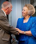 Prinses Beatrix reikt Zilveren Anjers uit op het Koninklijk Paleis in Amsterdam.<br /> <br /> Princess Beatrix at the award ceremony of theZilveren Anjers  in the the Royal Palace in Amsterdam.<br /> <br /> Op de foto / On the photo:  Prinses Beatrix en laureaat Jack Kooistra