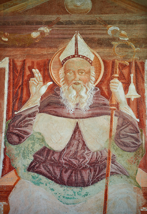 Religious mural of Saint Antonio Abate an a throne above with the canonical symbols of a bell and piglet, above the main portal, Sined by Cristoforo I Baschenis, 1474, on the exterior of the Gothic Church of San Antonio Abate,  Pelugo, Province of Trento, Italy .<br /> <br /> Visit our ITALY PHOTO COLLECTION for more   photos of Italy to download or buy as prints https://funkystock.photoshelter.com/gallery-collection/2b-Pictures-Images-of-Italy-Photos-of-Italian-Historic-Landmark-Sites/C0000qxA2zGFjd_k<br /> If you prefer to buy from our ALAMY PHOTO LIBRARY  Collection visit : https://www.alamy.com/portfolio/paul-williams-funkystock/san-antonio-abate-pelugo.html .<br /> <br /> Visit our ITALY HISTORIC PLACES PHOTO COLLECTION for more   photos of Italy to download or buy as prints https://funkystock.photoshelter.com/gallery-collection/2b-Pictures-Images-of-Italy-Photos-of-Italian-Historic-Landmark-Sites/C0000qxA2zGFjd_k<br /> .<br /> <br /> Visit our MEDIEVAL PHOTO COLLECTIONS for more   photos  to download or buy as prints https://funkystock.photoshelter.com/gallery-collection/Medieval-Middle-Ages-Historic-Places-Arcaeological-Sites-Pictures-Images-of/C0000B5ZA54_WD0s